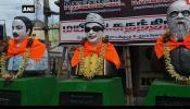 അണ്ണാദുരൈ, എംജിആര്, പെരിയാർ പ്രതിമകളില് കാവിത്തുണി പുതപ്പിച്ച നിലയിൽ